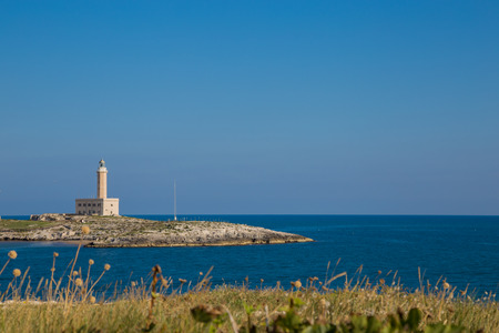 The lighthouse of Vieste on the Gargano in Puglia on a quiet day of October