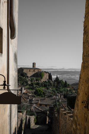 val: Campaign glimpse Tuscany seen from an alley in Montalcino, Italy. Stock Photo