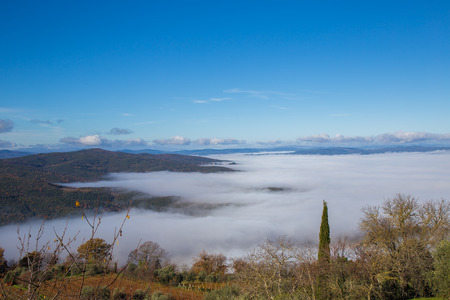 The Val dOrcia with its Tuscan hills, misty views from Montalcino.