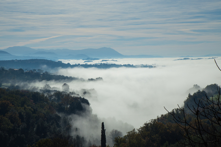 Sabina hills immersed in the fog.