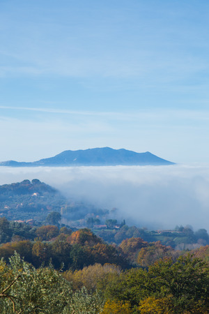 Sabina hills immersed in the fog, with the Monte Soratte in the background. Фото со стока
