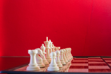 Chess white seen in plan and cut with red background.