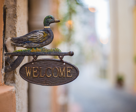Welcome sign of iron with duck Stock Photo