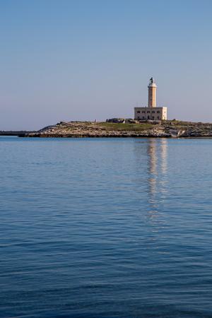 lamp light: Vieste Lighthouse with calm seas to October Stock Photo