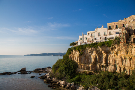 Houses built on the cliff overlooking the sea in Vieste Stock Photo