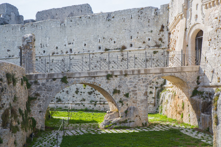 On the moat bridge to the entrance to the castle of Monte SantAngelo