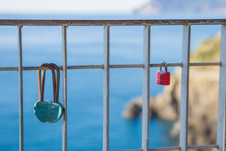 The promise of eternal love symbolized by the closure of a lock on the Ligurian coast.