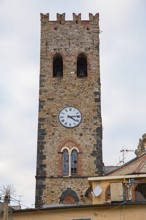 Bell tower with clock St. John Baptist in the village of Monterosso al Mare in the Cinque Terre in Liguria, Italy. Stock Photo