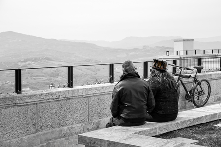 Two people, one man and one woman. They admire the black and white landscape.