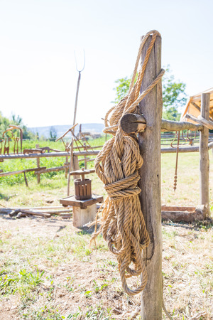 Old hemp rope attached to a wooden fence.