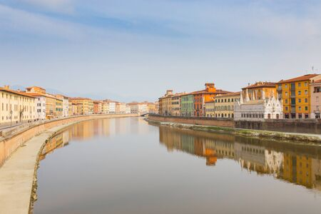 Pisa, view of the Arno river that passes in the city center and the church of Santa Maria della Spina.