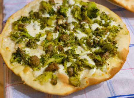 Homemade white pizza with mozzarella, broccoli and sausage Reklamní fotografie