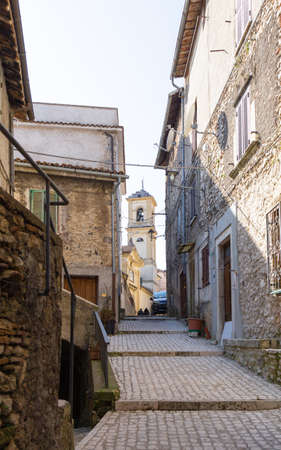 Orvinio, an old alley of the village with the bell tower in the background. Italy.
