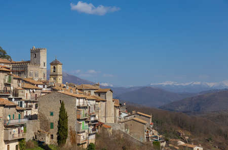 View of the old town of Orvinio with the snow-capped mountains in the background. Province of Rieti, Italy.