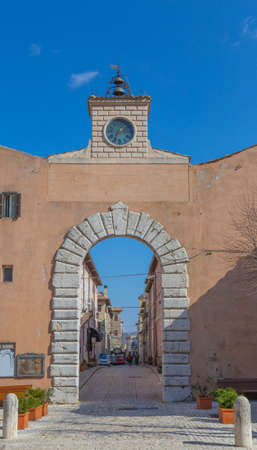 The clock above the entrance door of the old village of Orvinio in the province of Rieti. Italy.