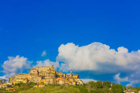 The village of Poggio Mirteto seen from below with a clear sky and part of the surrounding countryside. Located in the province of Rieti in Lazio in Italy.