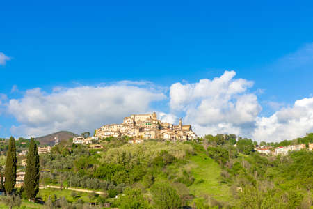 The village of Poggio Mirteto seen from below with a clear sky and part of the surrounding countryside. Located in the province of Rieti in Lazio in Italy. HDR Stok Fotoğraf