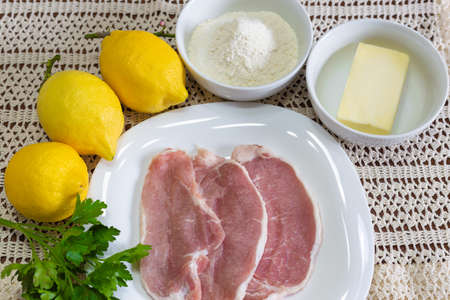 Ingredients for the preparation of lemon escalopes with butter, parsley and flour. Stok Fotoğraf