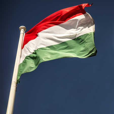 Flag of Hungary against a clear dark blue sky