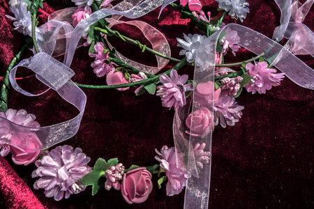 Pink and white ribbons and flowers on a velvet burgundy background . Vintage Wedding Decoration Reklamní fotografie