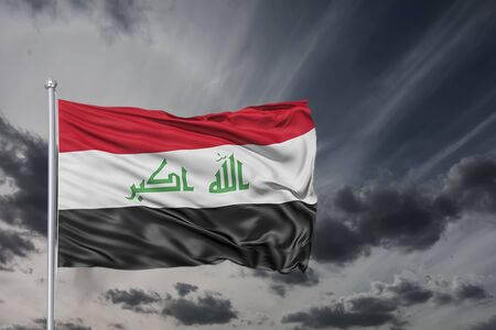 Real flag of the country Iraq waving in the wind against the background of storm sky and clouds. Reklamní fotografie