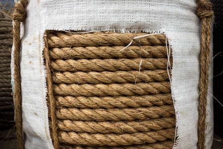 The spinning banana (Musa Textilis). Nautical rope from a spinning banana close-up of a manila hemp. Fiber braided nautical rope background. Technical fiber texture.