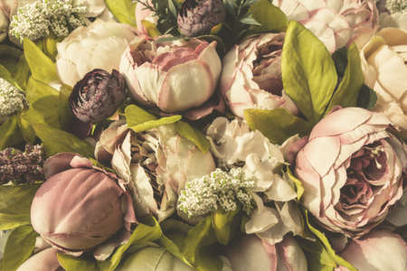 Vintage background of artificial flowers of the bride's bouquet. Colorful wedding bouquet close up.
