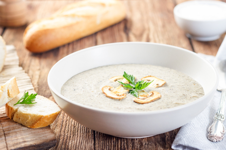 Mushroom cream soup on a wooden table. Archivio Fotografico