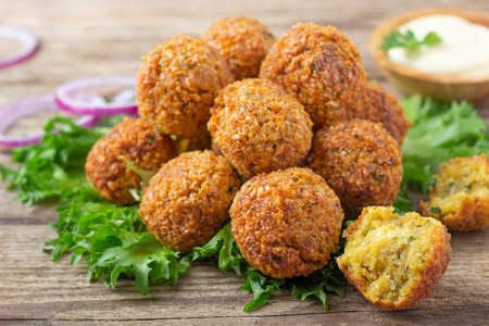 Vegetarian dish - falafel balls from spiced chickpeas on wooden rustic table. Standard-Bild