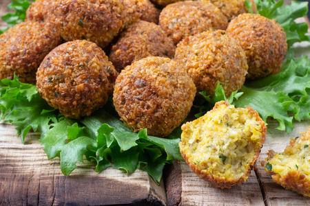 Vegetarian dish - falafel balls from spiced chickpeas on wooden rustic table. Stock Photo