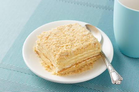 Russian Napoleon cake made of puff pastry and custard vanilla cream. Stock Photo