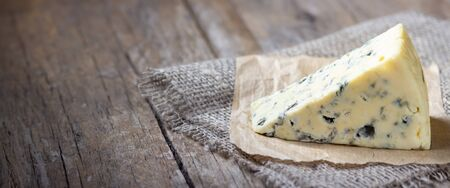 Blue cheese on wooden rustic table.