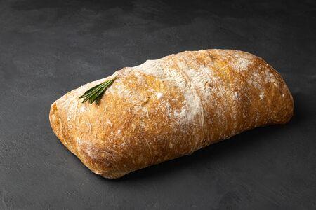 Crispy italian ciabatta bread on black background 版權商用圖片