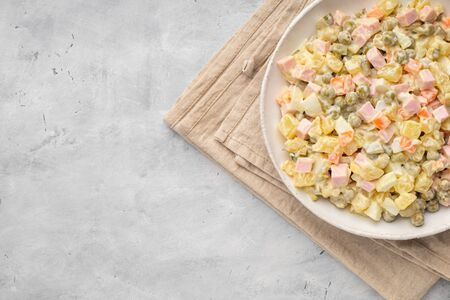 Russian salad Olivier with mayonnaise on plate. Above view. Copy space for text. 版權商用圖片