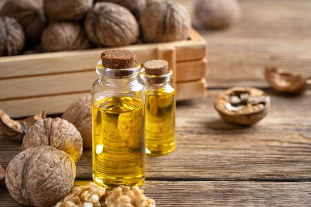 Essential oil of walnut on a wooden table. 版權商用圖片