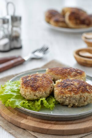Homemade fried meat cutlets on a plate.