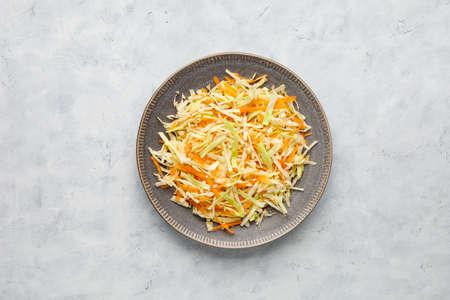 Fresh coleslaw salad from shredded cabbage and carrot. Reklamní fotografie