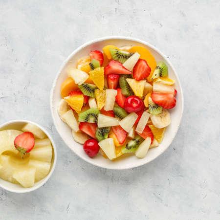 Fresh chopped fruit salad in a bowl. Stock fotó