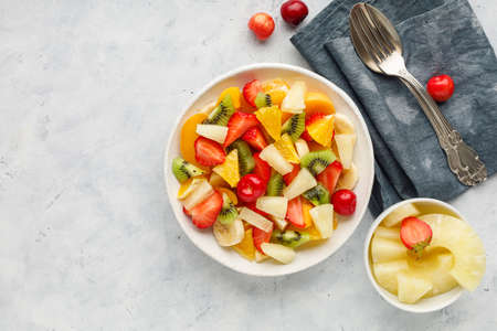 Fresh chopped fruit salad in a bowl. Top view.