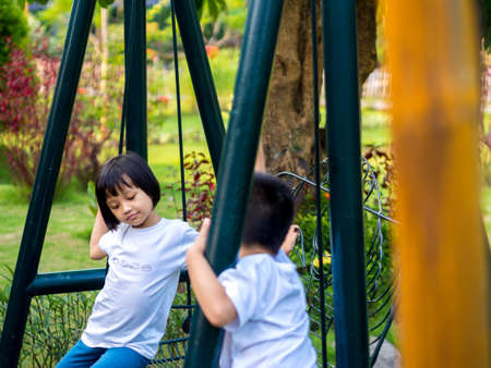 Chinese Children Climb on The Swings