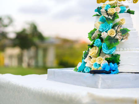 cake tier: Beautiful wedding cake with blue and yellow roses