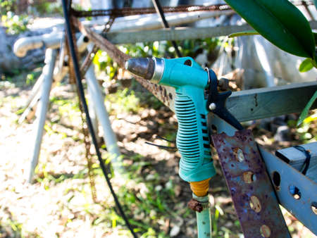 sprayer: Rusty Garden Hose Sprayer Stock Photo