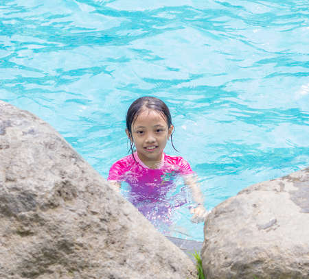Portrait of smiling Asian Girl (Kid) at Pool Side