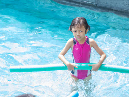 Portrait of Sad Asian Girl at Pool Side Stock Photo