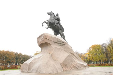 synod: The Bronze Horseman a monument to Peter the Great the founder of St Petersburg, Russia.Standing in Senatskaia Square facing the Neva River and surrounded by Senate and Synod buildings              Stock Photo