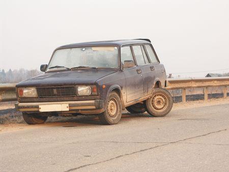 broken car on road . photo