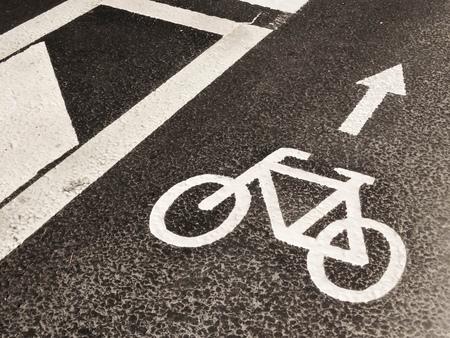 navigation mark: White bicycle town navigation mark on the grey asphalt