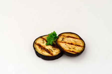 Slice of eggplant roasted on a grill with stripes Banque d'images