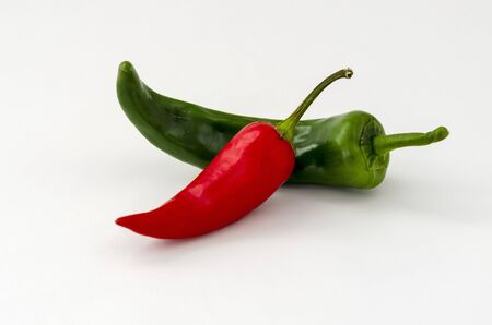 Red and green hot chili peppers isolated on white background,