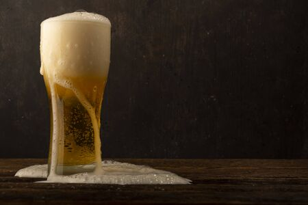 Glass beer on dark background with copyspace 写真素材